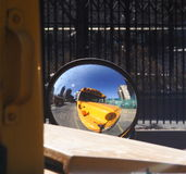 Yellow School Bus. 's reflection in a mirror Royalty Free Stock Photo