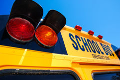 Yellow school bus. Close up of yellow school bus against bright blue sky Royalty Free Stock Photos