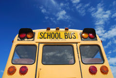 Yellow school bus. Against blue sky stock photography