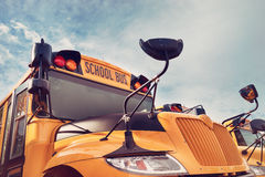 Yellow school bus against autumn sky Royalty Free Stock Photography