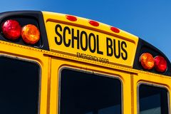Yellow School Bus in a District Lot Waiting to Depart for Studen. Ts Stock Photo