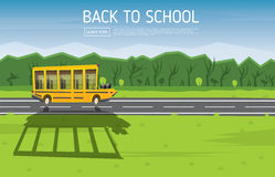 Yellow School Bus Driving Along Country Road. Royalty Free Stock Image