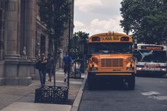 Yellow School Bus Beside Gray Concrete Building Royalty Free Stock Photography