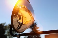 The Yellow school bus in the mirror. stock photo