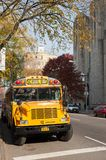 Yellow school bus in a New York city street in autumn Stock Photography