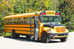 Yellow School Bus parked at Park. While the kids visit a local park Stock Image