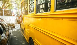Yellow school bus parked on the street of New York City Stock Photo