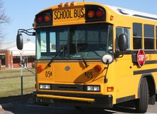Yellow School Bus Parked and Waiting Royalty Free Stock Image