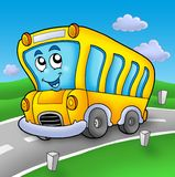 Yellow school bus on road Stock Images