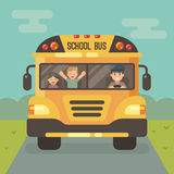 Yellow school bus with a driver and two children Stock Image