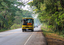 Yellow school bus on the road in Thailand Stock Image