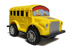 Yellow school bus toy. Isolated royalty free stock image