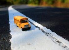Yellow school bus toy model. Royalty Free Stock Photo