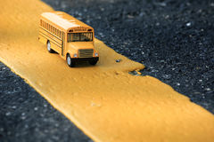 Yellow school bus toy model. Royalty Free Stock Image