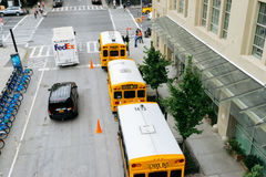 Yellow school buses on the street of New York. Royalty Free Stock Photos
