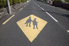 Yellow School Education Sign. Against Urban Street Background Royalty Free Stock Images