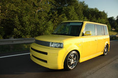 Yellow Scion xB driving on the Highway. A yellow Scion xB driving on the highway. See my portfolio for more automotive images royalty free stock photos