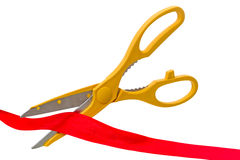 Yellow scissors and red ribbon Royalty Free Stock Image
