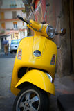 Yellow scooter. Photo of yellow scooter in the city royalty free stock photo
