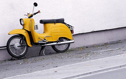 Yellow scooter Royalty Free Stock Images