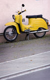 Yellow scooter Stock Photography