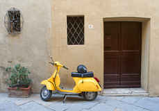 Yellow scooter Stock Images