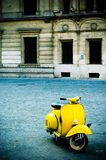 Yellow Scooter In Plaza Stock Image