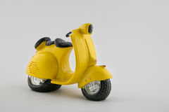 Yellow scooter. Retro yellow scooter  on white background Stock Images