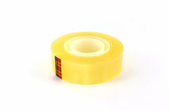 Yellow scotch tape roll. Stock Images