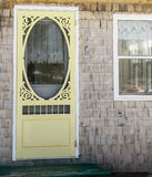 Yellow screen door Stock Photo