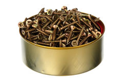 Screws in a can. Yellow screws in a can isolated over white background Stock Image