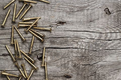 Yellow screws on the wooden table Stock Photos