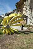 Yellow Sculpture by the Sea Bondi Beach. Yellow Flower Sculpture at Sculptures by the Sea Bondi Beach with One of the Scultures featured in the Sculptures by the royalty free stock photos