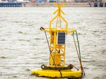 Yellow sea buoy Stock Photo