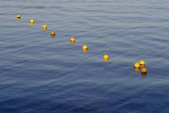 Yellow sea buoys Stock Photos
