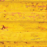 Yellow sea freight container background, rusty corrugated pattern, red primer coating, vertical rusted detailed steel texture. Crakcked grungy metal paint Stock Images