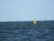 Yellow Sea water windmill blue sky Royalty Free Stock Photo