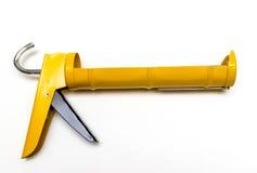Yellow sealant gun Royalty Free Stock Images