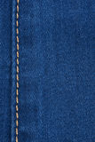Yellow seam on denim Royalty Free Stock Images