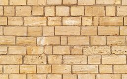 Yellow seamless brick wall texture stock photo