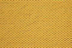 Yellow seamless roof tiles background. Stock Photos
