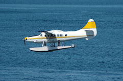 Yellow Seaplane. A seaplane approaching for touchdown on water Royalty Free Stock Photos