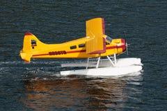 Yellow Seaplane. Ketchikan, AK, USA - May 24, 2016:  Yellow Seaplane cruising near Ketchikan preparing for takeoff Stock Images