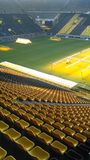 Yellow seats at Signal Iduna Park Stadium. This Stadium is the most famous stadium Germany after Allianz Arena & x28;Munich& x29; . This stadium is the home base Stock Image