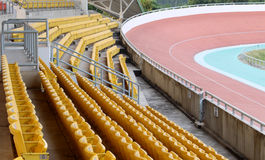 Yellow seats on stadium grandstand in cycling Royalty Free Stock Photography