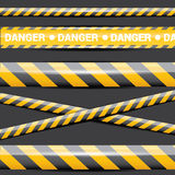 Yellow security warning tapes set Caution Royalty Free Stock Image