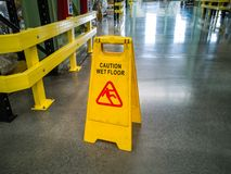 Yellow self standing wet floor warning sign royalty free stock photos