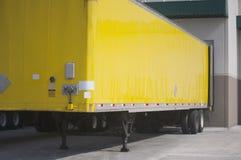 Yellow Semi Trailer at warehouse royalty free stock photo