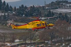 Medical helicopter landing. Yellow service medical elicopter landing in winter Stock Images