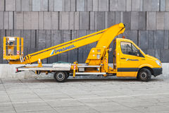 Yellow service Mercedes-Benz Sprinter Crane. Vienna, Austria - November 4, 2015: Yellow service Mercedes-Benz Sprinter Crane W906 pickup truck Royalty Free Stock Photography